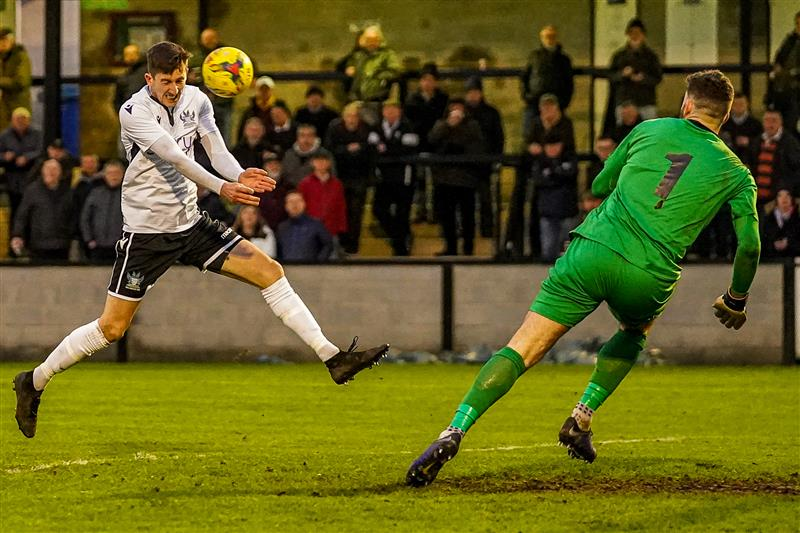 Toby blasts a header past the goalkeeper in scoring the Whites' second goal at the Ray Mac against Chesham United on 4 January in an impressive 3-2 victory. Happy New Year everyone!